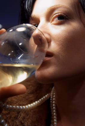 A woman drinking a glass of wine.
